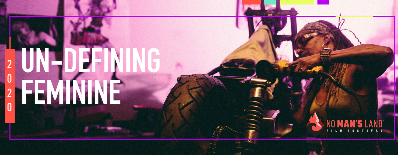 2020 Un-Defining Feminine: No Man's Land Film Festival. Black woman with goggles on and power tools working on a motorcycle.