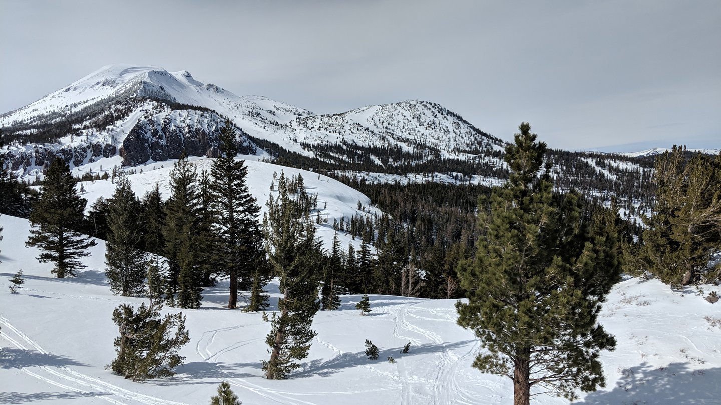 Sample view of the backcountry skiing and snowboarding opportunities around Mammoth Mountain. Backcountry slopes are in the foreground, and the mountains of the actual resort are in the background.