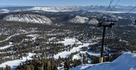 View of a part of the Mammoth Mountain Ski Resort. Skiing slopes are in the foreground, and the view fades into the Owens Valley further away.
