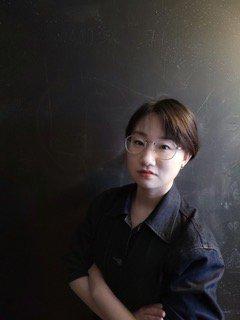 Yikun Wang headshot