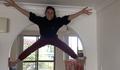 acrobat climbing a door jamb