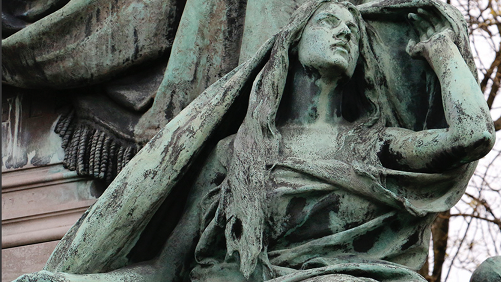 Image of a statue in a pose of mourning