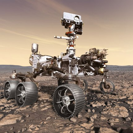 A large planetary rover sits on the Martian landscape