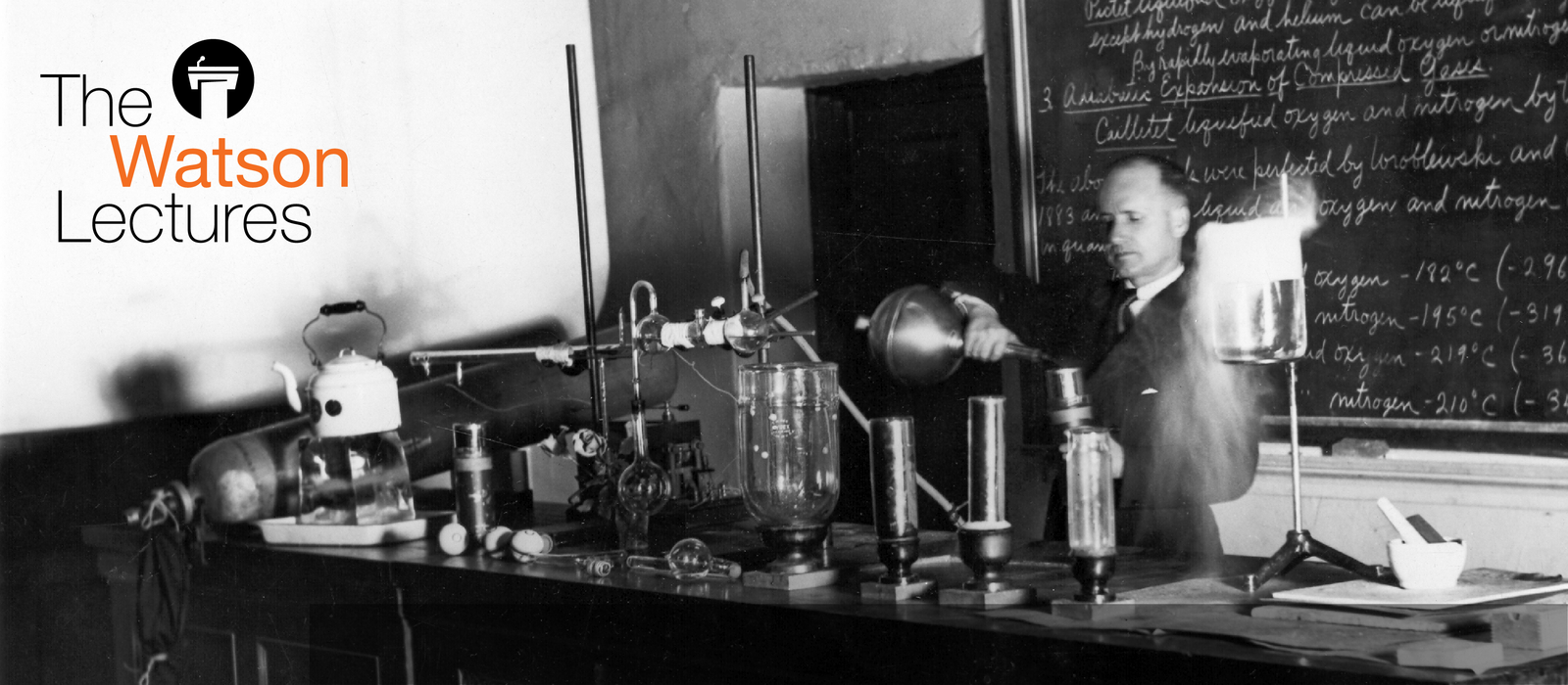 Black and white photo of the late Earnest C. Watson conducting his famous liquid air experiement in a Caltech lecture hall. The Watson Lectures logo is in the top left corner.