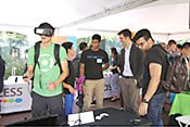 Student trying virtual reality headset.