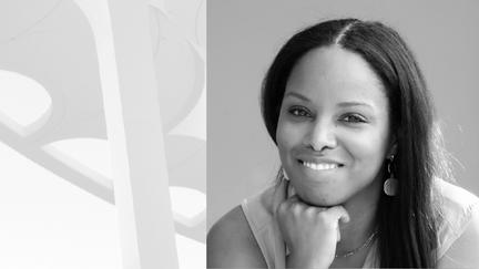Black and white headshot portrait of Tara Gomez-Hampton