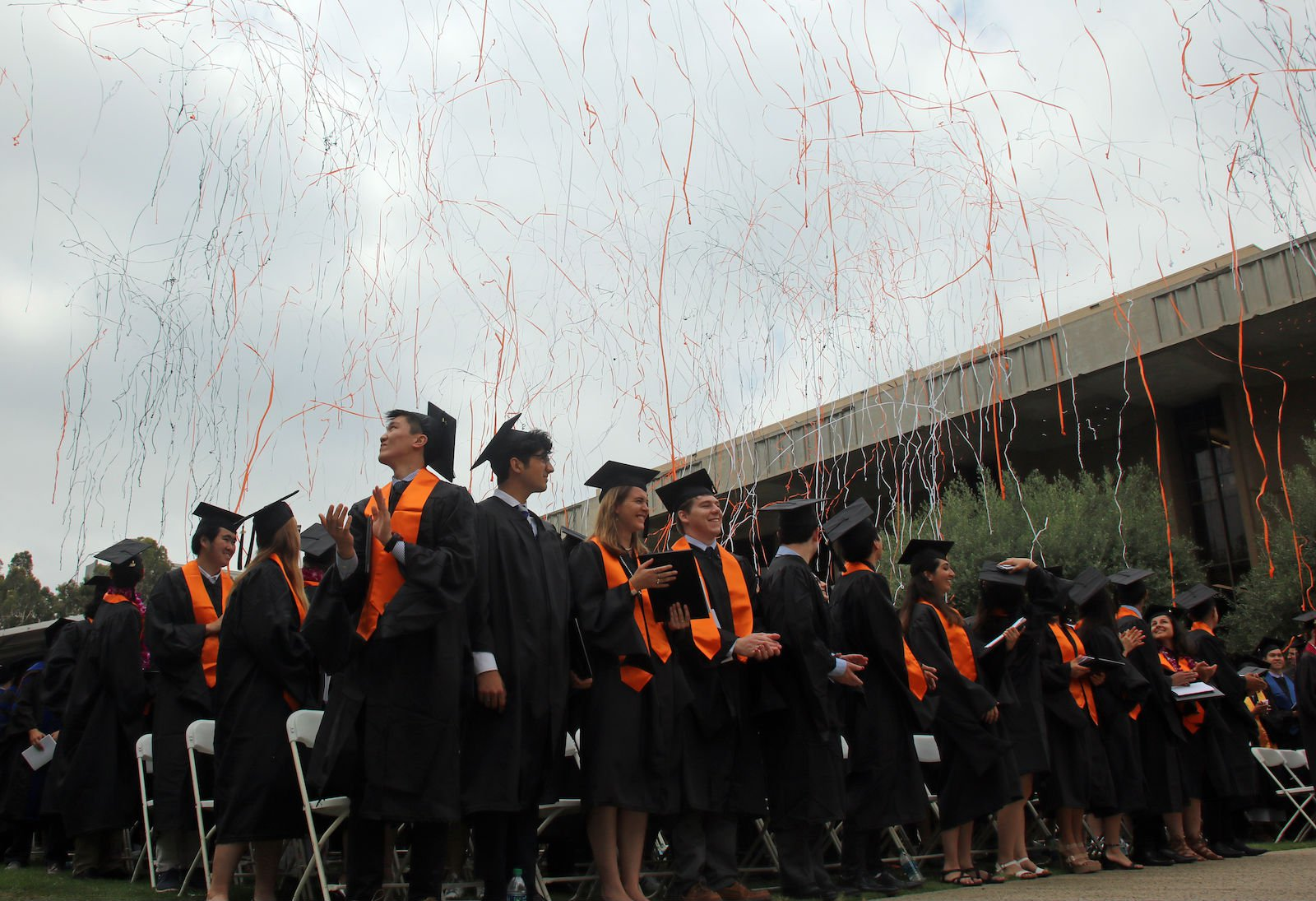 students at Commencement with confetti
