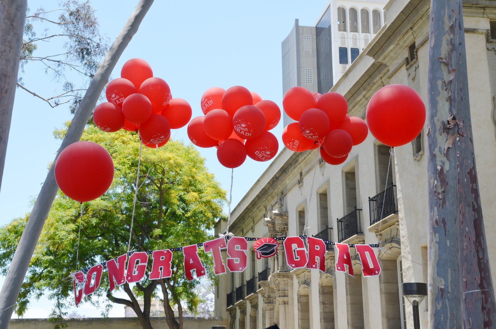 balloons and congratulations banner near Parsons-Gates Hall of Administration