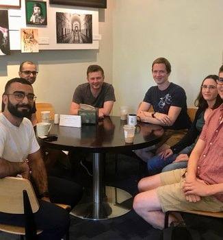 group photo coffee and career with Dr. Chris Heinrich
