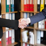 Picture of a handshake in an office setting