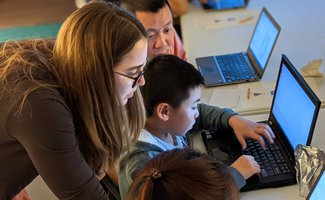 Caltech graduate student volunteers at Altadena Library's Family Coding Night