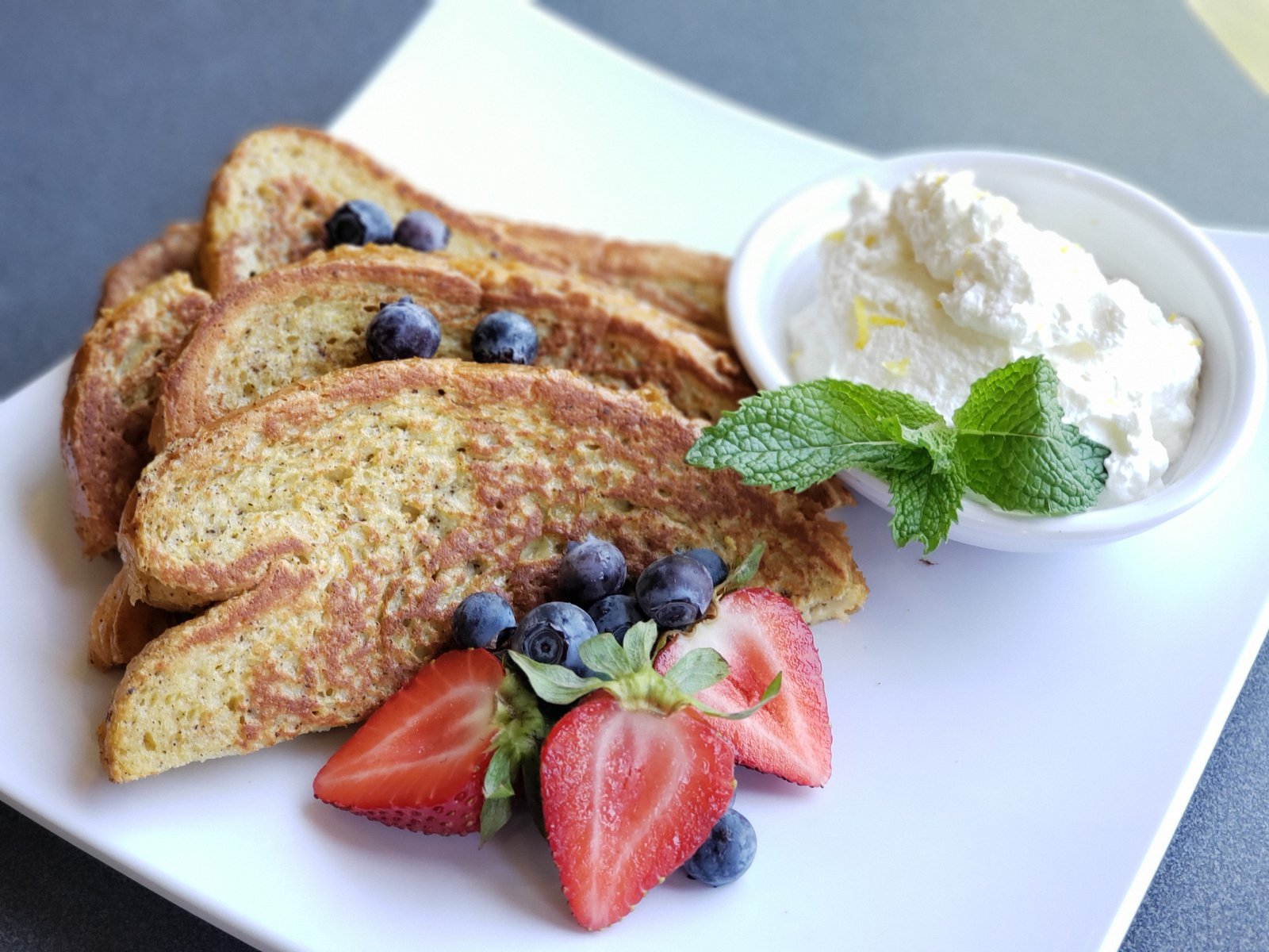 Challah french toast with berries and whipped cream