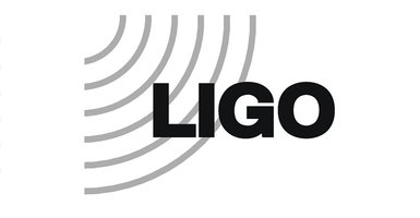 "LIGO logo: Grey semi-circles radiating out of top left corner of a white rectangle shape with bold, black text ""LIGO"""