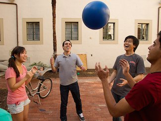 Students toss a ball in the air