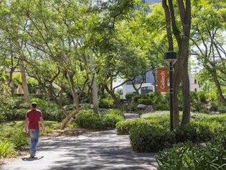A man walks through campus