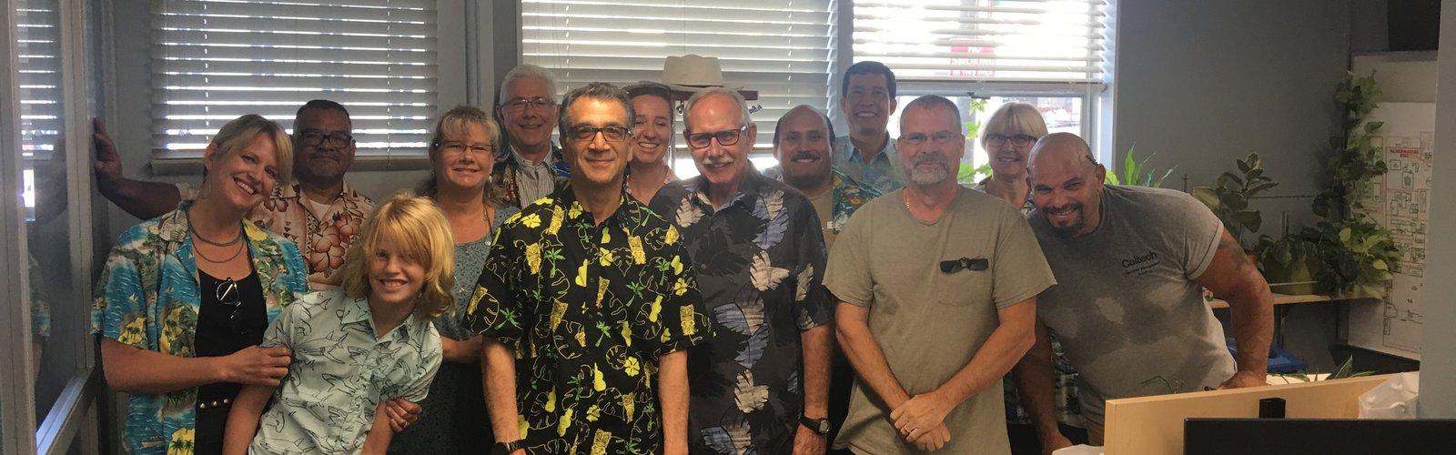 office birthday party goers wear Hawaiian shirts