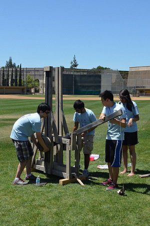 Students constructing a catapult for Ditch Day