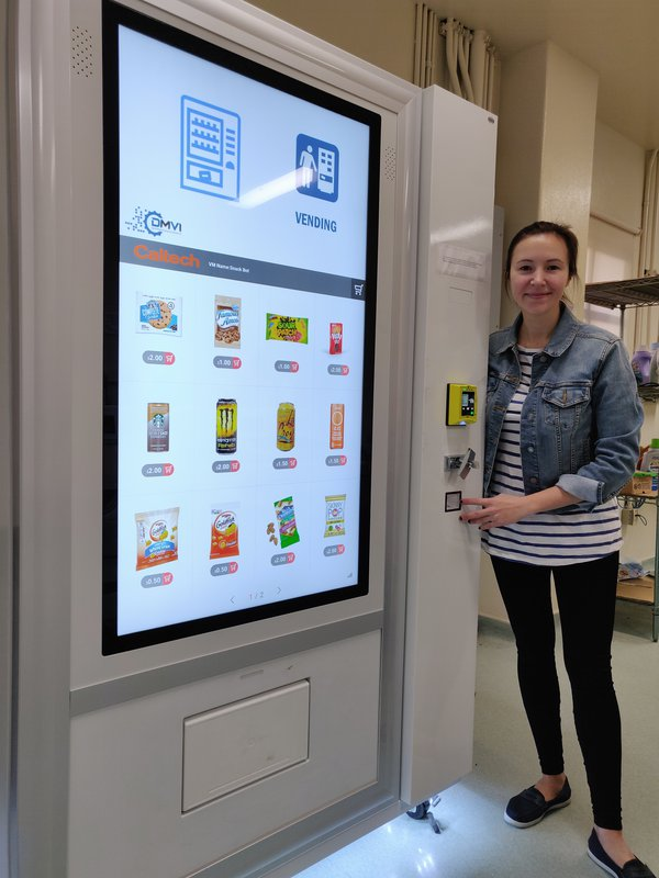 Anastasia with the customizable vending machine she installed on Caltech's campus.Anastasia with the customizable vending machine she installed on Caltech's campus.