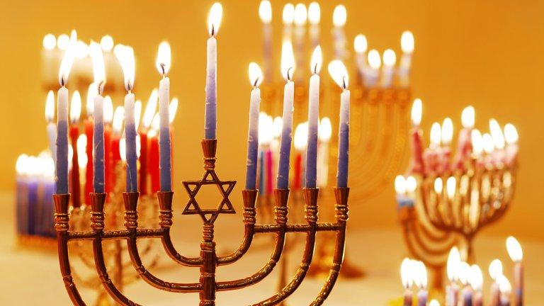 Hanukkiah with lit candles