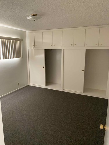 Bedroom at 1300 Cordova, carpeted, two closets, built in storage