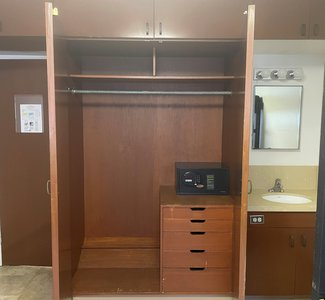 View of the interior of Marks/Braun built-in closet, equipped with additional drawers and a safe