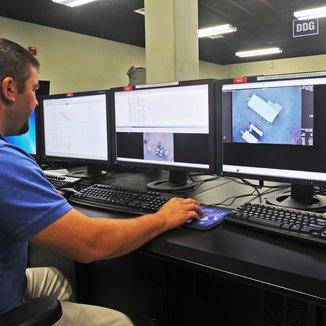 Engineer looking at monitors