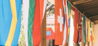 International flags hanging in Avery Courtyard
