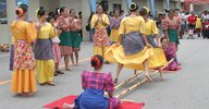 Group of people performing tinikling