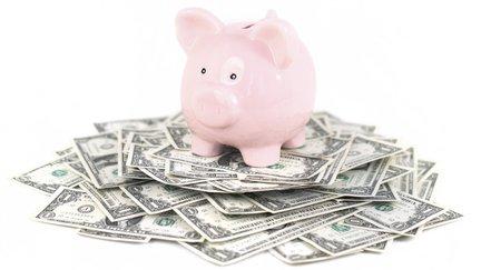 piggy bank on stacks of money