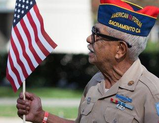 veteran carrying american flag