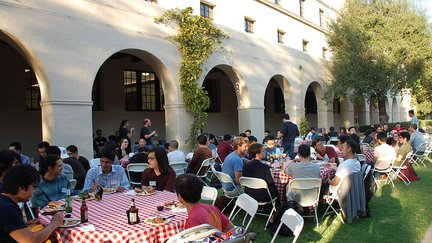 Photograph of tables and people at 2018 Chen Institute BBQ