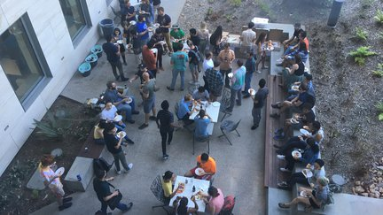 Aerial view of people socializing on a garden patio.