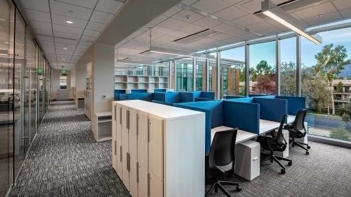 Lab write up area with tables, blue dividers and lockers.