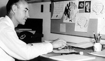 Roger Sperry working at a desk