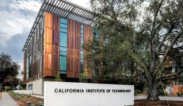 West side view of the Chen Neuroscience Research Building, showing the copper facade, Caltech sinage and oak tree.