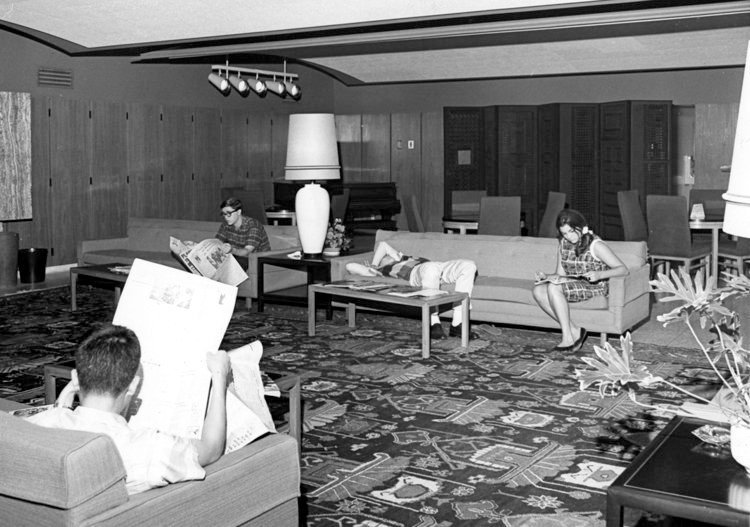 Black and white image of students reading and relaxing in the Winnett Center circa 1960