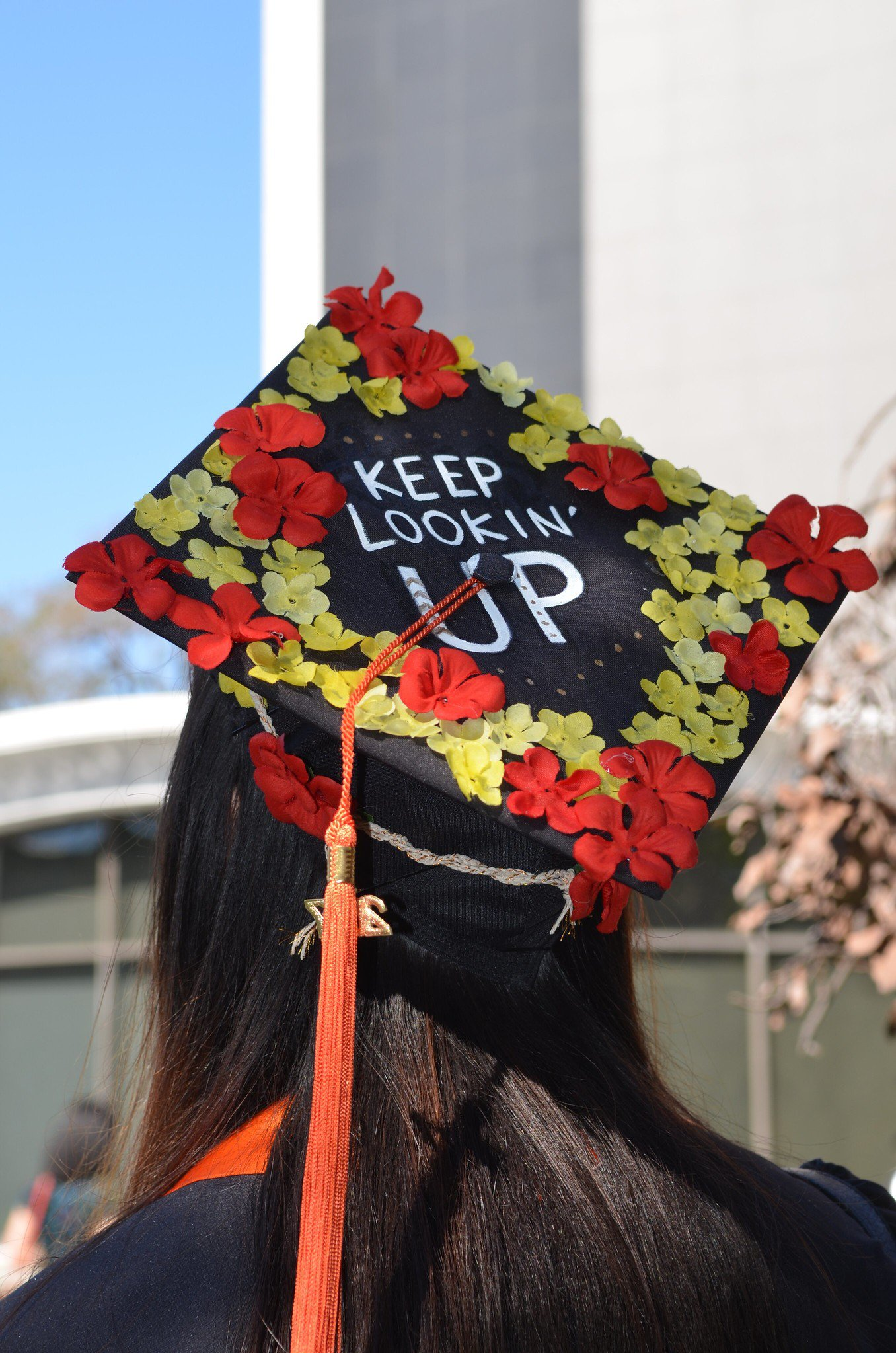 Back view of graduating student in hat saying Keep Looking Up