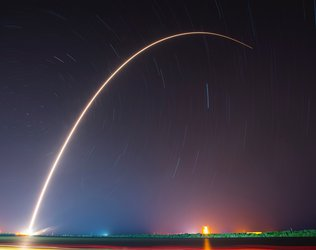 Night Sky rocket launch arc