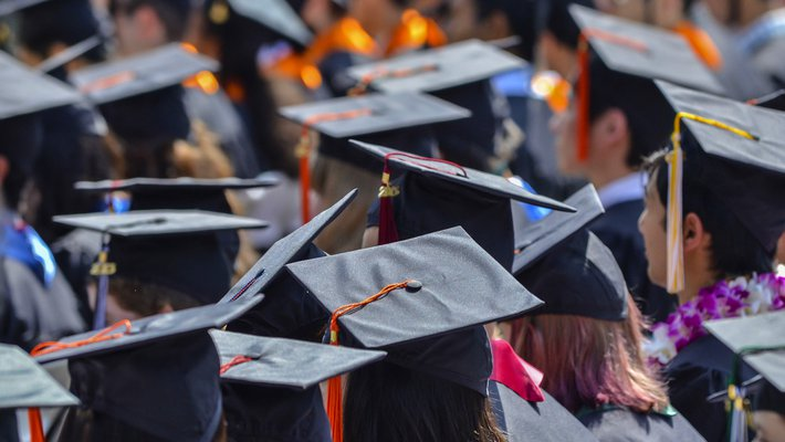 Photo of graduating students showing mortarboards.