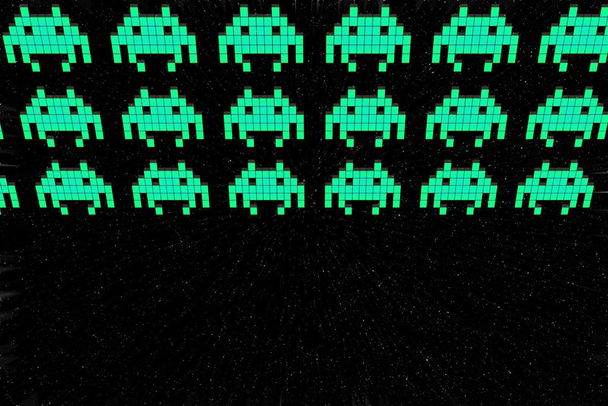 """Rows of small pixelated """"space aliens"""""""