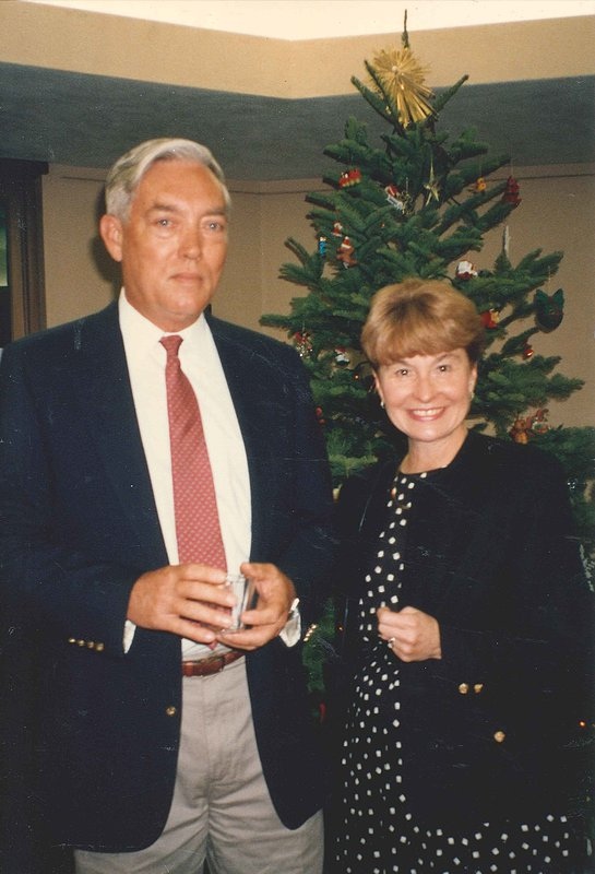 David Grether and Susan Grether stand in front of a Christmas tree.