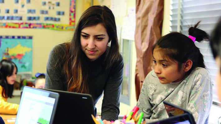 A Caltech computer science student helps a Pasadena third grader learn to code.