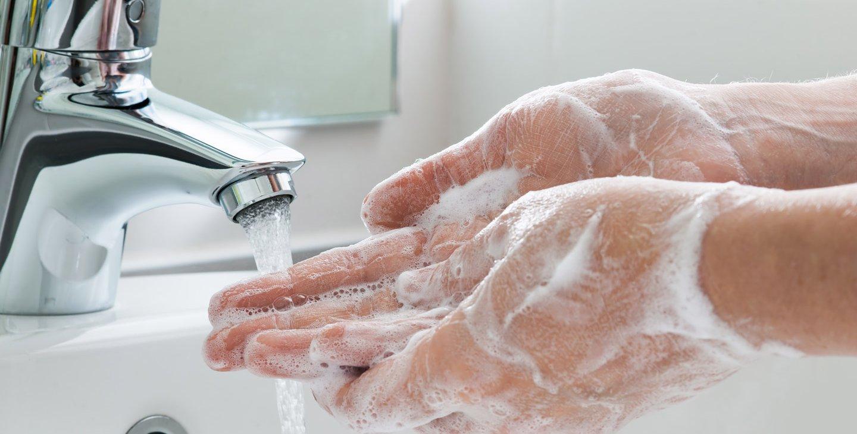 Photo of hand washing.