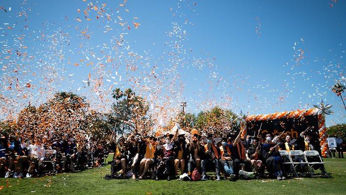 The 2021 graduates fill the air with confetti.