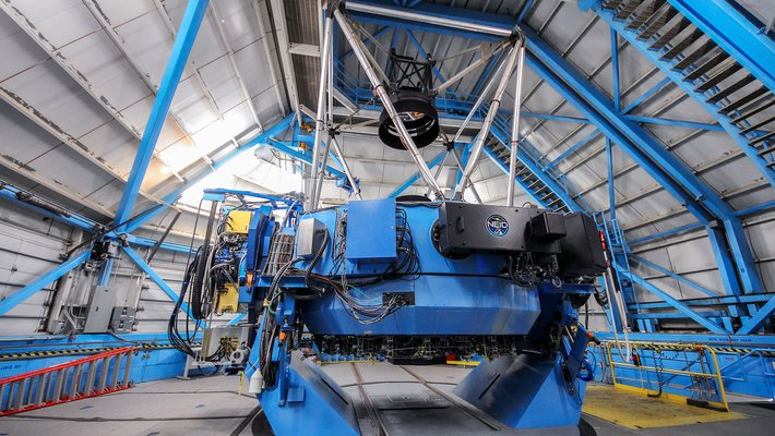 A portion of NEID, called the port adaptor, is seen here on the WIYN telescope.