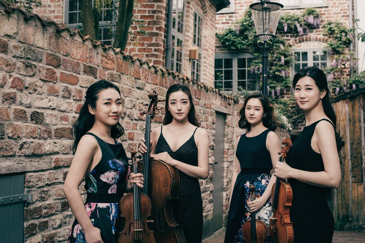 group photo of the chamber music group the Esmé Quartet