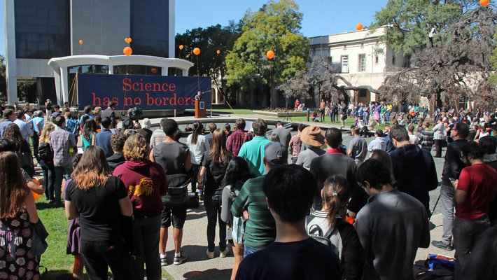 More than 500 people flocked to the March 1 gathering at Millikan Pond to support international members of the Caltech community.