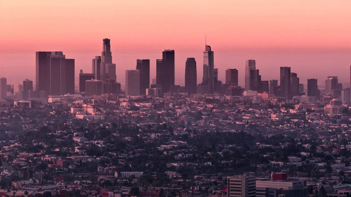 A photo showing the Los Angeles skyline near sunset. The air is hazy.