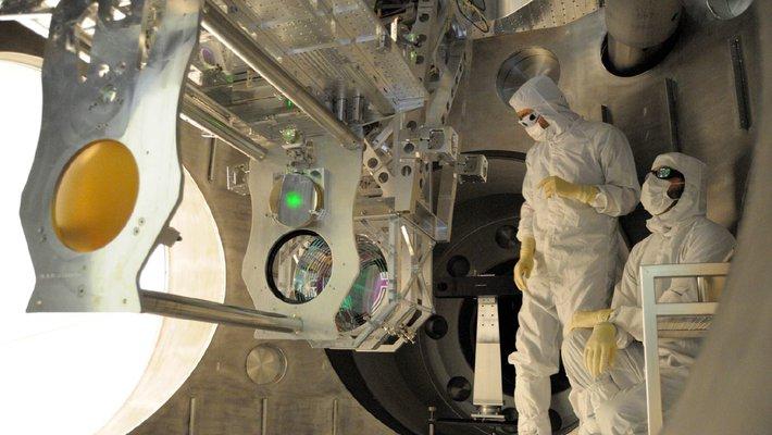 Engineers installing Advanced LIGO upgrades.