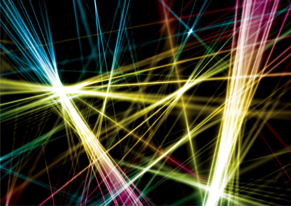 An artist's rendition of multi-colored laser beams chaotically arranged in front of a black background.